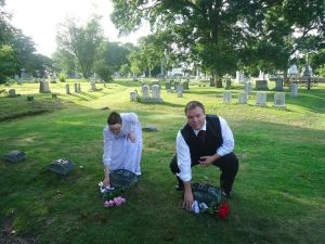 Laying Flowers on the Graves of Andrew and Abby Borden